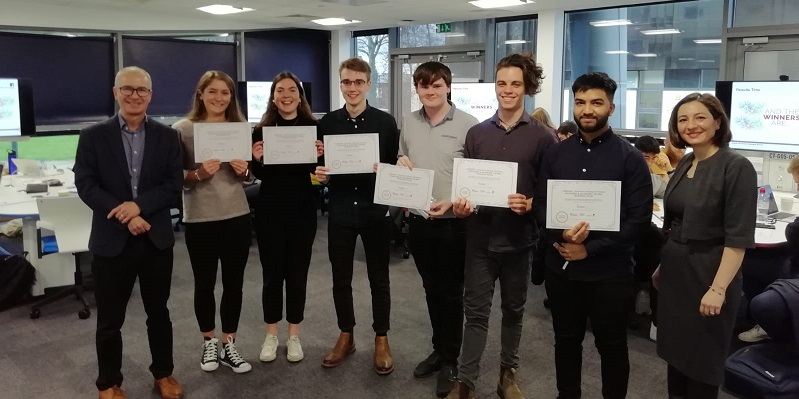 Photo of winning innovation team with certificates for Dragons Den panel event.