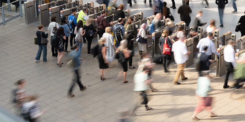 Commuters at a busy train station