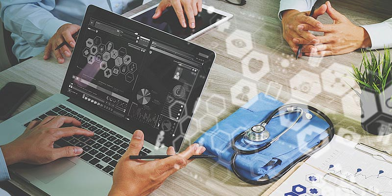 Doctors working on a laptop