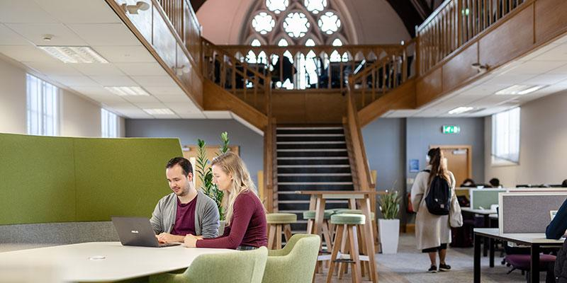 Postgraduate private study room with wooden beams and stained glass windows