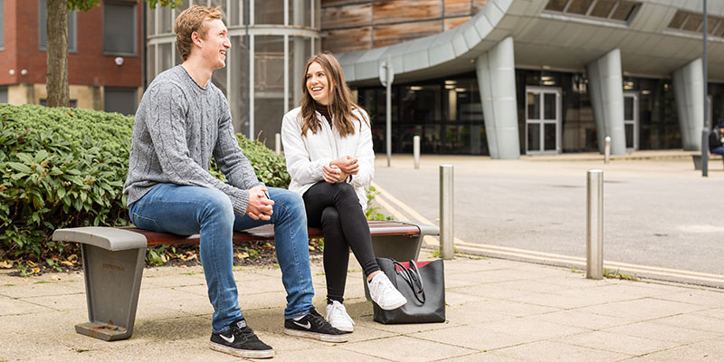 Two students outside the Charles Thackrah building