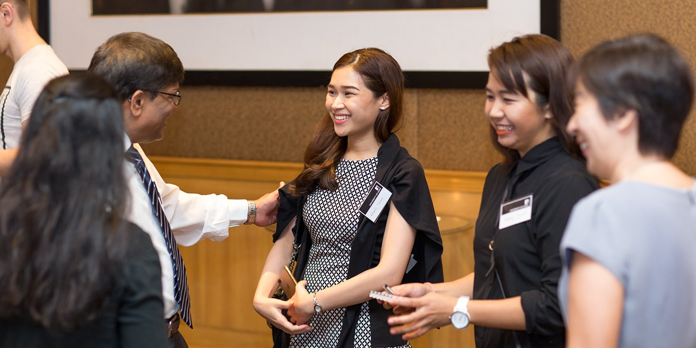 Alumni and prospective students networking at an overseas event