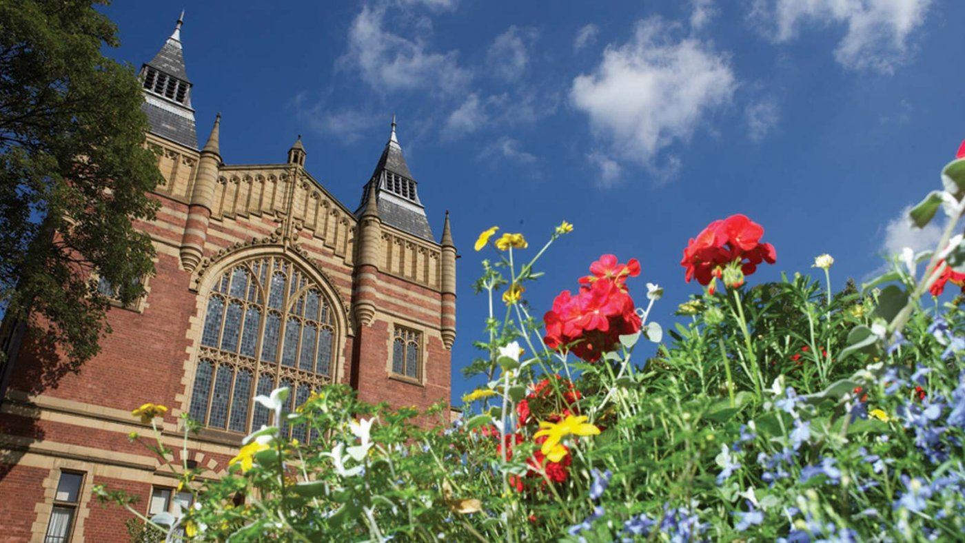 Great Hall with blue skies and flowers