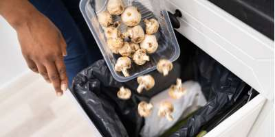 Pack of mushrooms being thrown into a bin