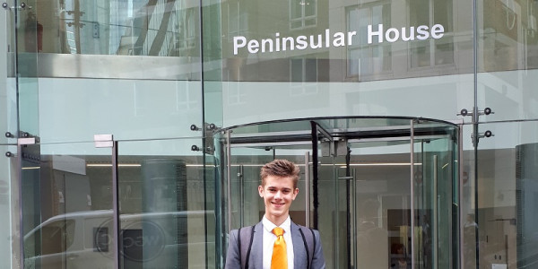 Photo of James Tucker standing outside Peninsular House