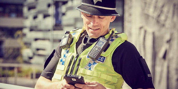 Police officer using mobile technology