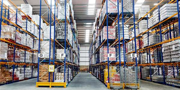Inside a warehouse with tall shelves