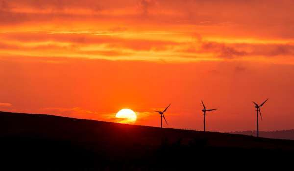 Amber sunset with a wind turbine in the background