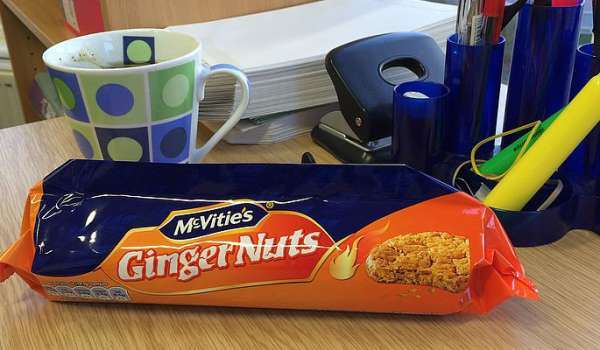 Pack of McVities Ginger Nuts laying on a desk