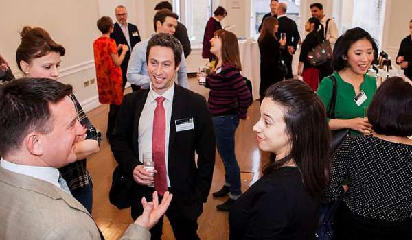 Delegates networking at an event