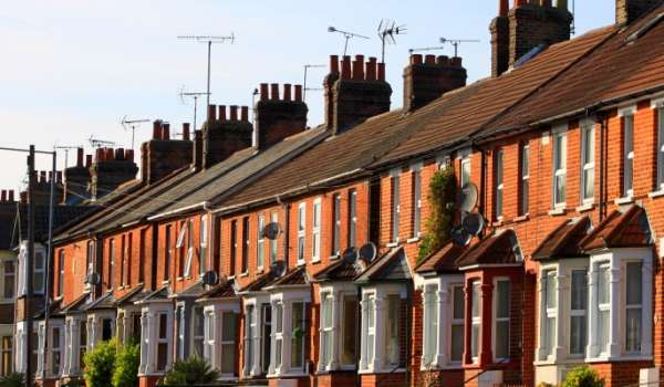 Row of terraced houses on a sunny day