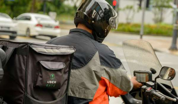Photograph of an Uber motorcycle delivery rider
