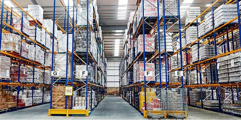 Large shelving units full of stock in a warehouse